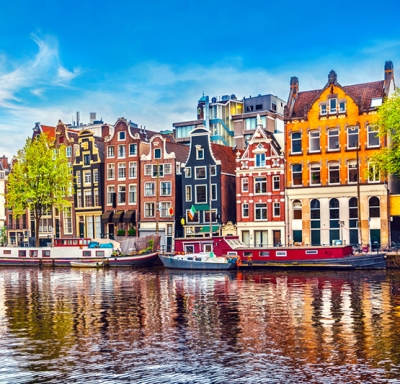 Panoramic view of houses along the Amstel River during springtime in Amsterdam, The Netherlands