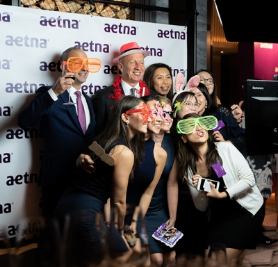 Aetna International brokers having photobooth fun at a 2018 Hong Kong broker appreciation event