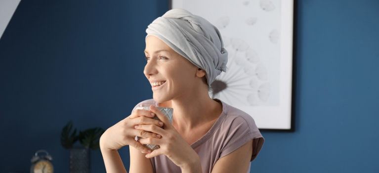 Female chemotherapy patient enjoying a cup of tea after undergoing treatment