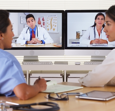Female doctors on a video conference call with colleagues