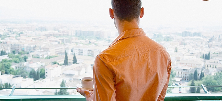 Man drinking espresso and enjoying view