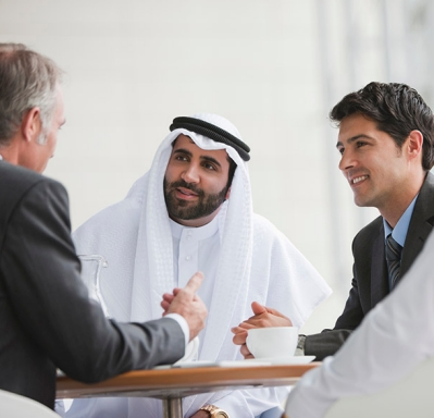 Expats and Dubai businessmen meeting
